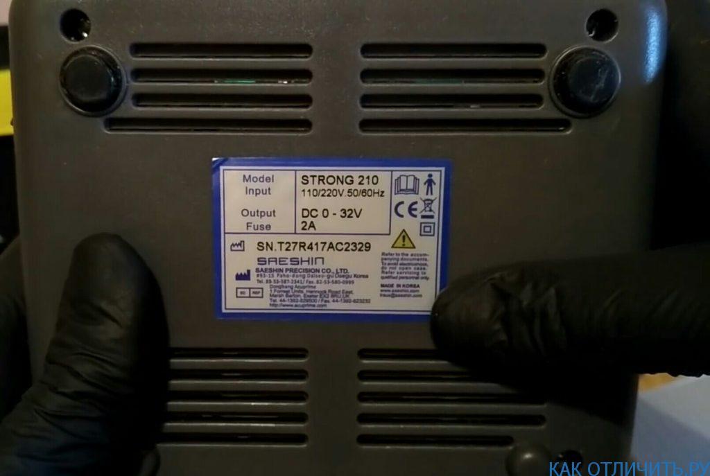 поддельная наклейка на аппарате Strong 210