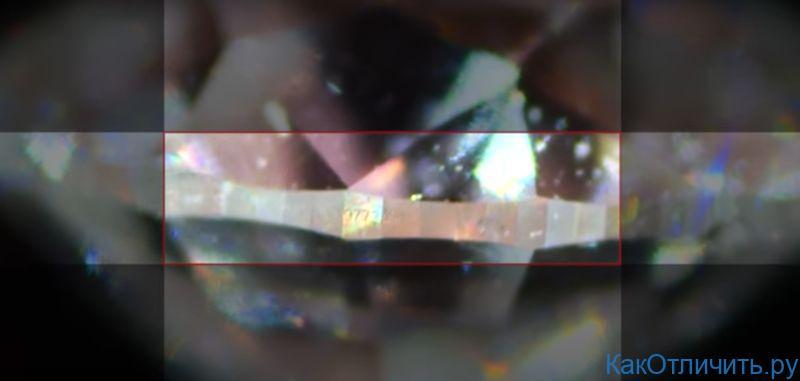 Уникальный номер бриллианта, выгравированный на камне